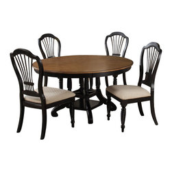 Hillsdale Furniture - Hillsdale Wilshire 5-Piece Round Dining Room Set w/ Side Chairs in Rubbed Black - The Wilshire collection features a blend of cottage styling with country accented details. The blend of Americana and English country gives the Wilshire collection a look and feel that will enhance any home. The craftsmanship is evident in each piece. Opening a drawer is a reflection of old world craftsmanship, complete with tongue and groove drawer bottoms, English dovetail drawer construction and thick solid wood drawers. Finishes have been painstakingly applied to give years of enjoyment.