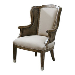 """Uttermost - Carolyn Kinder Nessa High Back Wing Chair - High back and curvy wings make a grand statement in a warm, sun-washed pecan finish on solid white poplar with cane sides and beige faux lambskin, accented by nickel nail head trim and metal tips on the grooved, tapered legs. Seat height is 18""""."""