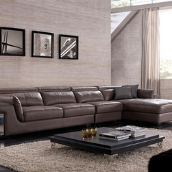 Anicka Signature Leather Sectional - This Anicka Signature Sectional's impressive styling is showcased through its adjustable headrests, stainless steel accents and extra soft padded seating.