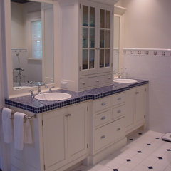 traditional bathroom vanities and sink consoles by Cook & Cook Cabinetry
