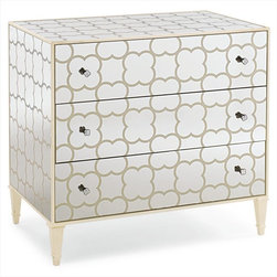 Schnadig - Caracole Cookies & Creme - A fresh and fun look, this closed storage piece is all about bold design and exciting options. We simply painted a cookie design in creme paint on a clear mirror (you never know where inspiration will come from). The fun comes in how you elect to use this stylish piece: a hall chest, end table, bathroom cabinet for storage, or even a secret cookie hiding place.
