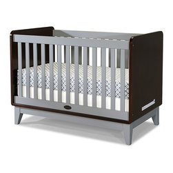 Zutano - Espresso & Cloud Tivoli Convertible Crib - Complete Baby's nursery with this stunning convertible crib bed. It boasts a modern design that transforms into a toddler bed and then a full-size daybed with use of the included conversion rail. Best of all, this crib features multiple mattress height levels for added convenience. Crafted from high-quality wood, its rich, nontoxic finish ensures lasting wear for years to come.   Includes crib and toddler rail Mattress not included 30.95'' W x 42'' H x 54.33'' D Mattress platform height options Stationary sides Wood / composite JPMA-certified Assembly required Imported