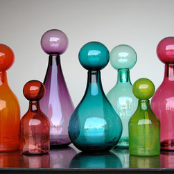 Elizabeth Lyons Glass Jewel Tone Jar Collection - This combination of jewel tones, hand-blown glass and beautiful shapes is truly breathtaking. I think the capper is literally those globe tops that unify all of the pieces. This jar collection was created by Atlanta glass artist Elizabeth Lyons, and I cannot get enough of it!