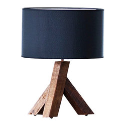 Asymmetrical Elm Lamp - Crafted from solid reclaimed Chinese elm wood, this well-designed lamp allows the base to be the star of the show. The natural charm of the asymmetrical base is sure to catch attention and intrigue your guests, while the dark shade provides an elegant contrast. Place the lamp in your favorite corner and let it shine.