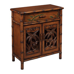 None - Creek Classics Bamboo Accent Chest - This Polynesian inspired cabinet is loaded with details. From the simulated bamboo frame,to the palm trees on the two doors allowing a peak at the adjustable shelf,all finished in Tupai Brown tone.