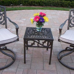 Oakland Living - 3-Pc Patio Rocker Set - Includes one end table, two cushioned swivel rockers and metal hardware. Fade, chip and crack resistant. Lightweight. Hardened powder coat. Warranty: One year limited. Made from rust free cast aluminum. Traditional lattice pattern and scroll work. Handcasted. Antique bronze finish. Minimal assembly required. Rocker: 23 in. W x 17.5 in. D x 38 in. H (33 lbs.). End table: 17.5 in. W x 17.5 in. D x 19 in. H (15 lbs.). Overall weight: 55 lbs.This rocker set will be a beautiful addition to your patio, balcony or outdoor entertainment area. Our swivel rocker sets are perfect for any small space, or to accent a larger space. We recommend that the products be covered to protect them when not in use. To preserve the beauty and finish of the metal products, we recommend applying an epoxy clear coat once a year. However, because of the nature of iron it will eventually rust when exposed to the elements. The Oakland Mississippi Collection combines southern style and modern designs giving you a rich addition to any outdoor setting.