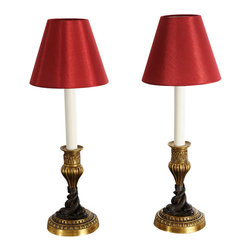 Pair of English Regency Candlestick Lamps - A pair of English candlestick lamps like these with sea creatures twisted around the base would set off a console table or sideboard nicely. The rich red shades add a touch of regency.