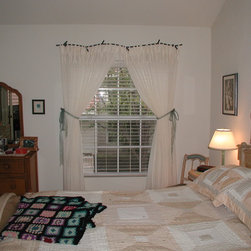 Draperies - Sheer tie top curtain installed on decorative wrought iron hardware from Ironwork by Orion.