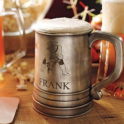 """NFL Antique Silver Beer Stein - Like the glass-bottom drinking vessels that would allow kings to keep an eye on their court, our beer stein will let you keep an eye on the game! Add a classic or current NFL team logo with your name beneath it for a personal touch. 6"""" wide x 4.5"""" deep x 5.5"""" high Made of brass with an antique-silver-plated finish, and glass bottom. Personalize with your name for free. Team glassware is offered with or without personalization. Monogram will be placed on the side of the stein below the chosen NFL logo. Catalog / Internet only."""