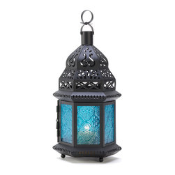 "Koehler Home Decor - Koehler Home Decor Blue Glass Moroccan Style Candle Lantern - Ocean blue is the color of serenity, beautifully showcased in this intricate metalwork Moroccan lantern. Ornate cutouts allow a candle's golden light to provide a fascinating counterpoint of lacy light. Weight 1.2 lbs. 5.75""x 5""x 12.25"" high. Candle not included.Weight 1.2 lbs. Dimension:5.75""x 5""x 12.25"". ."