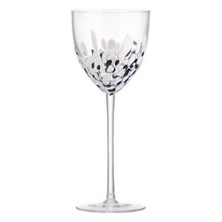 Hollywood Black and White Wine Glass - Molten glass in a floating abstract design of classic black and white grabs the spotlight. Long slender stem add willowy elegance to each unique glass, handmade by master European glassmakers.Handmade glassPulled stemFire-polished rimHand washMade in Poland