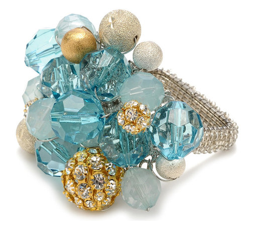Crystal Bauble Napkin Ring - Seafoam / Gold / Silver - Mix the appeal of geometry with the welcome of natural textures when you use the Octagon Raffia Placemat, a simple eight-sided mat made from naturally-colored woven raffia. Durable and inviting with its impression of imported naturalness, the placemat offers myriad options for composing a dining-room table, while also looking relaxed yet chic under a console centerpiece. This item is sold as a single unit.