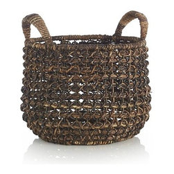 Medium Zuzu Basket with Handle - A chunky open cross-weave, rich natural color variations and angled, wrapped handles distinguish these artisanal, satchel-shaped baskets. Available in three sizes, each handmade piece will exhibit individual characteristics.
