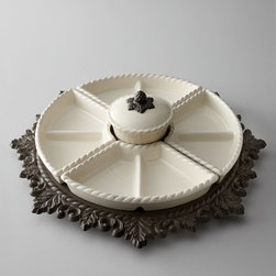 """GG Collection - Lazy Susan - CREAM - GG CollectionLazy SusanDetailsLazy susan has four removable divided dishes and a covered bowl.Handcrafted of cast aluminum and ceramic.Hand painted.Ceramic pieces are dishwasher and microwave safe.21""""Dia. x 5.125""""T.Imported.Designer About GG Collection:GG Collection is the brainchild of two friends Dixie Harrigan and Leigh Anne Baysinger who wanted to make accessories for those who prefer classical decor to modern influences. Together they started a movement for the revival of the classic European style beginning with Tuscan-inspired canisters and spice jars then expanding to include dinnerware and other decor. Their creative combination of metal stoneware and mouth-blown glass achieves the relaxed European-country style they were striving to create."""
