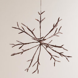 World Market - LED Snowflake Battery-Operated Hanging Light - A unique holiday decoration, our natural brown snowflake is covered with 56 white LED lights that sparkle and twinkle. This exclusive light can sit on a shelf or hang from the ceiling.