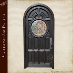 Front Doors - Custom door hand made from solid wood, raised panel design, leaded glass portal window, hand forged custom door handle. Made by master level craftsmen at Scottsdale Art Factory.  All American handmade custom doors since 1913.