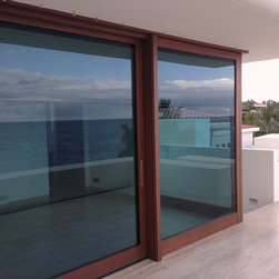 Residence in Cabo San Lucas, Mexico - These blinds were custom made for sliding doors and pocket doors. Their depth is only 1 1/4 inches and they come with a special swing stop so they don't move while the doors are opened. They also don't get caught in the panels because of their unique installation. The chain also got a special swing stop...The blinds are made for doors up to 9 feet in width and 11 feet in height....ask for more information.