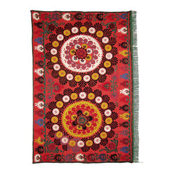 Antique Suzani - Suzani textiles come from Uzbekistan and are delicately stitched with an array of patterns. They can be used as throws on the sofa or chair or hung on the wall. They can also be used over a table.