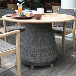 Teak and Wicker Outdoor Dining Furniture Table - I love the combination of a wide wicker base with a teak table. The materials are stable, durable and great looking.