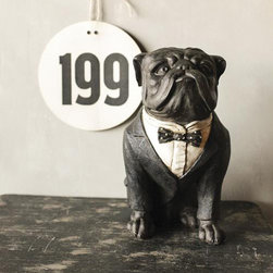 Ready to Serve Bulldog - This dapper Ready to Serve Bulldog is sure to add a little personality to a relaxed and gentlemanly setting. The charming resin bulldog is the perfect accent piece to add a playful touch to a more industrial and refined room. Place by the door for guarded entry, or have him keep watch from the bar top or bookshelves.