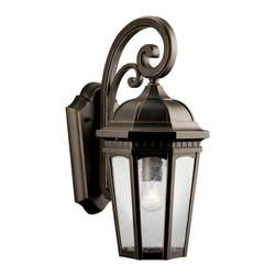 Kichler 1-Light Outdoor Fixture - Rubbed Bronze Exterior - One Light Outdoor Fixture Uncluttered and traditional, this attractive wall lantern from the courtyard collection adds the warmth of a secluded terrace to any patio or porch. What a welcoming beacon for your home`s exterior. Done in a rubbed bronze finish with clear-seedy glass. 1-light, 150-w. Max. Width 8-1/2, height 18, extension 11. Height from center of wall opening 8. Backplate size: 5-3/4 x 10-1/2. U. L. Listed for wet location.