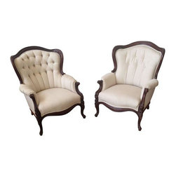 Used Victorian Tufted Arm Chairs - A Pair - Re-upholstered white tufted arm-chairs with beautiful wood carved frames. Extremely comfortable and supportive seats.  The pair coordinate but are slightly different. Perfect for avoiding that matchy-matchy thing! Set of two or just one. Please contact support@chairish.com if you're interested in purchasing a single chair rather than the pair.