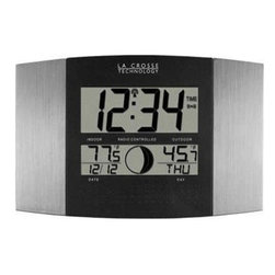 La Crosse Technologies - LC Atomic Digital Wall Clock - La Crosse Atomic Digital Wall Clock with Moon Phase & IN/OUT Temperature in Silver/Black finish... Wireless outdoor temperature (F or C); Monitors indoor temperature (F or C); 12 Moon phases; Atomic time and date with manual setting; Automatically updates for Daylight Saving Time (on/off option); 12/24 hour time display; Perpetual calendar; Time zone setting; Time alarm with snooze; 4 languages to choose from: English  French  German  Spanish; Wall hanging or free standing; Low Battery Icon for Both Units.  This item cannot be shipped to APO/FPO addresses. Please accept our apologies.