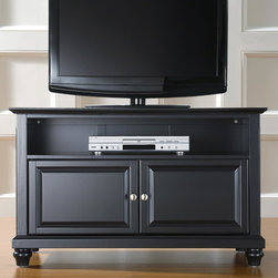 """Crosley - Cambridge 42"""" TV Stand - Enhance your living space with one of Crosley's impeccably-crafted TV stands. This signature cabinet accommodates most 42"""" flat panel TVs and is handsomely proportioned featuring character-rich details sure to impress. Raised panel doors strategically conceal stacks of CDs/DVDs, gaming components and various media paraphernalia. Open storage area generously houses media players and the like. Adjustable shelving offers an abundance of versatility to effortlessly organize by design, while cord management systems tame the unsightly mess of tangled wires. Customize our distinct cabinets by selecting one of four collection styles (featuring tapered, traditional. turned or bun feet) in your choice of one of three signature Crosley finishes. This customizable cabinet approach is designed for easy assembly, built to ship and constructed to last. Features: -Cambridge collection. -Constructed of solid hardwood and veneer. -Raised panel doors. -Adjustable shelf for storing electronic components, gaming consoles, DVDs and other items. -Wire management. -Adjustable levelers in legs. -Accommodates 42"""" TV. -ISTA 3A certified. -Manufacturer provides a 3 month warranty against defects in material and workmanship."""