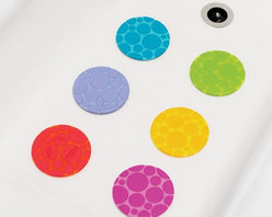 Munchkin - Grippy Dots Textured Bath Safety Grips - Grippy Dots are fun and cool textured non-slip discs that help keep little ones from slipping and sliding in the tub or shower, but also warn parents when the water is too hot for little bodies. ?HOT HOT HOT? develops on the middle dot when the water is at an unsafe temperature. This great alternative to a bathmat also features a backing with a dozen suction cups for a super secure grip that can be positioned wherever they are needed. Each pack contains six Grippy Dots in multiple hues.