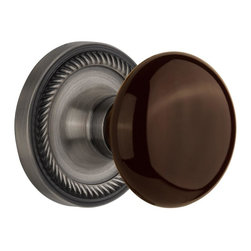 Nostalgic - Nostalgic Passage-Rope Rose-Brown Porcelain Knob-Antique Pewter (NW-710469) - Blending rich detail and subdued refinement, the Rope Rosette in antique pewter captures a style that has been a favorite for centuries. Adding our rich, Brown Porcelain knob only serves to compliment the warm, earthen hues in your home. All Nostalgic Warehouse knobs are mounted on a solid (not plated) forged brass base for durability and beauty.