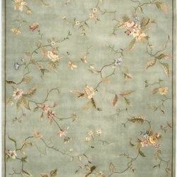 Nourison - Nourison Hand-tufted Julian Aqua Wool Rug (3'6 x 5'6) - Flowers,vines in glimmering hues of pink,peach,green,blue,and gold elegantly weave and wind across an effervescent aqua background. With a glamorous gleam and luscious pile,this deluxe hand-tufted,hand-carved rug simply embodies extravagance.