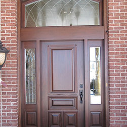 Homestead Doors, Inc. - Custom Mahogany Entryway and Front Door made from Solid Wood - Price is approximate and will vary depending on your actual door size requirements, wood species, and other options.