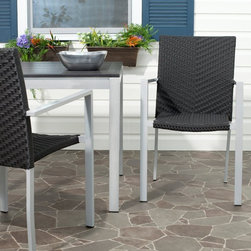 Safavieh - Safavieh Cordova Stackable Dining Chair - Set of 2 - FOX5206A-SET2 - Shop for Chairs and Sofas from Hayneedle.com! At once substantial and slim the Safavieh Cordova Stackable Dining Chair - Set of 2 gives you modern-looking seating that transitions well between almost any style or setting. The cool look of the clean-lined profile has very contemporary look while the metal-frame construction provides a sturdy seat that is strong enough to stand up to the elements and sturdy enough that it won't feel like you're sitting in flimsy temporary seating. Meanwhile the PE wicker weaving softens both the look and feel of this seat that welcomes even more traditional decor. These durable materials also make these chairs ideal for indoor or outdoor conversation or dining areas.About SafaviehConsidered the authority on fine quality craftsmanship and style since their inception in 1914 Safavieh is most successful in the home furnishings industry thanks to their talent for combining high tech with high touch. For four generations the family behind the Safavieh brand has dedicated its talents and resources to providing uncompromising quality. They hold the durability beauty and artistry of their handmade rugs well-crafted furniture and decorative accents in the highest regard. That's why they focus their efforts on developing the highest quality products to suit the broadest range of budgets. Their mission is perpetuate the interior furnishings craft and lead with innovation while preserving centuries-old traditions in categories from antique reproductions to fashion-forward contemporary trends.