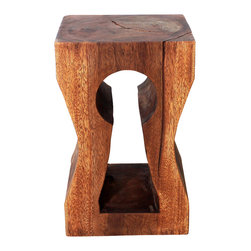 Kammika - Keyhole Sustainable Wood 12 x 14 x 22 inch Ht w Eco Friendly Livos Chestnut Oil - Our Classic Sustainable Wood Keyhole 12 inch Depth x 14 inch Width x 22 inch Height in Eco Friendly, Natural Food-safe Livos Chestnut Oil Finish Stool or Stand has a slot artistically carved through a solid block of arched wood exposing the growth rings on the sides. The carving is unique to look at and through. This piece is finished in Eco Friendly, Natural Food-safe Livos Chestnut Oil that creates rich dark brown tones. The more it is buffed the more lustrous the surface will become. This piece serves wonderfully as an end table or stool; place two side by side for a longer table, and it can alternately be used as a stand or coffee table. Made from the thick branches of the quick-growing Acacia tree in Thailand - where each branch is cut and carved to order (allowing the tree to continue growing), each is hand carved from a single piece of Monkey Pod. Each is a Work of Art! Craftspeople from the Chiang Mai area in Northern Thailand create these pieces with the simplest of tools. After each Monkey Pod Wood (Acacia, Koa, Rain Tree grown for wood carving) piece is kiln dried, carved and sanded, it is rubbed in Livos Chestnut oil that creates a highly water resistant and food safe finish. These natural oils are translucent so the wood grain detail is highlighted; this are then polished to a matte finish. There is No oily feel and cannot bleed into carpets. After each piece is carved, kiln dried, sanded, and rubbed with Livos oil, they are packaged with cartons from recycled cardboard with no plastic or other fillers. As this is a natural product, the color and grain of your piece will be unique, and may include small checks or cracks that occur when the wood is dried. Sizes are approximate. Products could have visible marks from tools used, patches from small repairs, knot holes, natural inclusions, and/or worm holes. There may be various separations or cracks on your piece wh