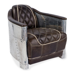 Kathy Kuo Home - Aarnio Aluminum/Espresso Leather Armchair - Rosie Riveter strikes again. With its riveted aluminum paneling, this armchair calls to mind the early days of aviation, sparking your imagination as well as your living room. Playful white piping stands out against the rich brown leather, inviting you to sit back and enjoy this comfortable, unique chair.