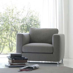 Estel - Estel | Mini G Armchair - The Mini G Armchair is clean and contemporary, with sleek lines and comfortable cushions that make it perfect for a variety of applications. Featuring a beech and poplar wood structure and spring system on metal frames with elastic bands, select a fabulous fabric cover that is conveniently removable, or a soft fixed soft leather upholstery option. The armchair's fill is composted of fireproof polyurethane foam, while the seat is upholstered with foam and dacron and the backrest is filled with feathers and an undeformable insert. Feet are finished in sleek chromed steel.