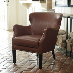 Ballard Designs - Dixon Leather Chair - Hand covered in buttery leather. Black leather features nickel nailheads. Cognac leather features Aged Brass nailheads. Hand tacked nailhead trim. Full grain leather. The perfect proportions of our Dixon Leather Chair deliver maximum comfort and vintage style without overwhelming your space. Hardwood frame has gently curved back and slightly open arms that follow your own natural contours.Dixon Leather Chair features:. . . . .