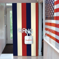 Stripes Americana Removable Wallpaper - Redesign your room as an ode to Americana with worry-free peel and stick wallpaperin glorious red and navy stripes.