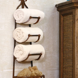 Rustic Iron Hanging Towel Rack with Basket - The rustic finish belies the artistry in this three slot towel rack complete with scrolled basket for artisanal soaps, bathing sponges or washcloths. Hand crafted in cottage industries abroad. These unique, hand-crafted accessories are imported from small cottage industries in Colombia, Honduras, Haiti, Morocco, and more.