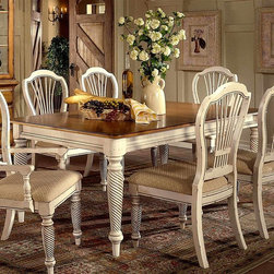 Hillsdale - Wilshire Collection Wood Dining Table w Antiq - Carved legs and warm contrasting finishes of antique white and antique pine give this country inspired dining table a welcoming look that will be an enduring addition to your home's dining area decor. The piece is made of wood and includes two extension leaves. Includes two 18 in. leaves. Country accented details. Blend of cottage styling. Antique White finish. Chairs sold separately. 73 in. W x 44 in. D x 30 in. H. With  Two 18 in. W Leaf: 30 in. H x 109 in. W x 44 in. DThe Wilshire collection features a blend of cottage styling with country accented details. The combination of Americana and English country gives the Wilshire collection a look and feel that will enhance any home. The craftsmanship is evident in each piece. Finishes have been painstakingly applied to give you years of enjoyment.