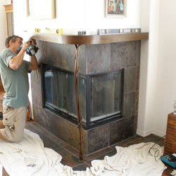 Custom Steel Mantle - This was a custom built steel mantle for a corner fireplace. It was designed to fit with the existing structure and complement the decor of the room. It was built off-site and then installed over the slate hearth. (Installation not included in price.)