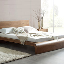 Roma Natural Walnut Bed - The Roma has a bold design which commands attention in any bedroom. The sumptuous curves of this bed make it the perfect contemporary bed to suit as the centerpiece of any modern bedroom. The bed incorporates sprung-slats to ensure maximum comfort and durability.