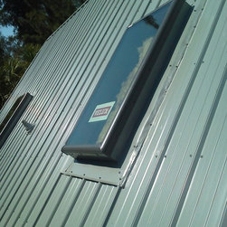 Siesta Key Roof - New skylights bring in light and protect the home with hurricane rated glass and frames by Velux