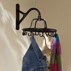 Wall-Mount Garment Rack - This wall-mount rack would open up floor space.