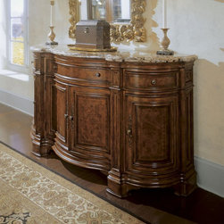 Universal Furniture - Villa Cortina Marble Top Sideboard Credenza - 409679-C - Shop for Buffets and Side Boards from Hayneedle.com! With its rounded doors and luxurious marble top the Villa Cortina Marble Top Sideboard Credenza lends an old world look to your well-appointed dining room. This credenza features laurel burl banded exotic hedguia borders and decorative hardware for added opulence. It's well-built with highly decorative veneers and select hardwood solids in a Villa Cortina finish. This credenza includes three drawers perfect for flatware storage. Three doors open to reveal a shelf and storage tray for all your dining essentials.About Universal Furniture InternationalRecognized as a leader in exceptionally crafted home furnishings including bedroom and dining room items entertainment centers and more Universal strives to make items that are styled to endure but always remain fresh. They make it a goal to include features that fit the way their customers live today and to find prices that put high-quality products within reach. These are the principles that guide the work at Universal essential elements of good affordable and smart design.