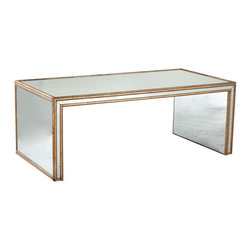 Antiqued Art Deco Coffee Table - Beauty defined. Antiqued-glass mirrors on all sides to bring in added light, and framed in gilded wood for the finishing touch. The grand impact this will make in your home is sure to keep your gazing at it for hours.