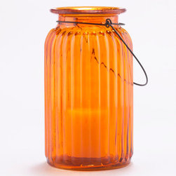 Orange Ribbed Glass Lantern Candleholder - These pretty lanterns can be used indoors or out to add sunshine. The glow of the candle can really change the mood of a space.