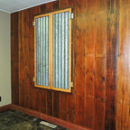 Rendezvous Showroom - Custom made reclaimed corrugated metal shutters with barn wood frames. Beautiful patina, delivered by years of weather , has been carefully preserved.  These shutters are operational providing security and privacy to your home, cabin or office. These are custom made to each project specifications.