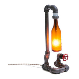 Peared Creation - Pint Table Lamp - This lamp is constructed from industrial style black iron piping. The vintage bottle is firmly secured by custom rubber gaskets that grasp the bottle without causing damage. A low wattage bulb is used to illuminate the vintage amber bottle producing a warm ambient light. A red rotating faucet handle serves as a switch to turn the light on and off. Power is supplied by a retro style cloth covered lamp cord and plug.