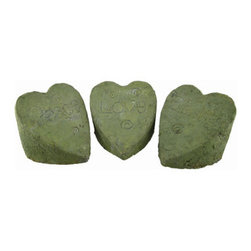 Set of 3 Heart Shaped Garden Stones Peace, Love, Blessings - Add a decorative accent to your garden or flower beds with this set of 3 heart shaped stones. They are angled and read `Peace,``Love,` and `Blessings,` are made of cement, and are green in color. Each stone measures 7 inches wide, 7 inches deep, and 6 inches high. This set makes a lovely gift for your favorite gardener, or a nice housewarming gift for a friend.